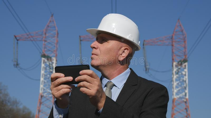 Energy Working in Energetic Industry Using Mobile in Maintenance Work.  royalty free stock photo