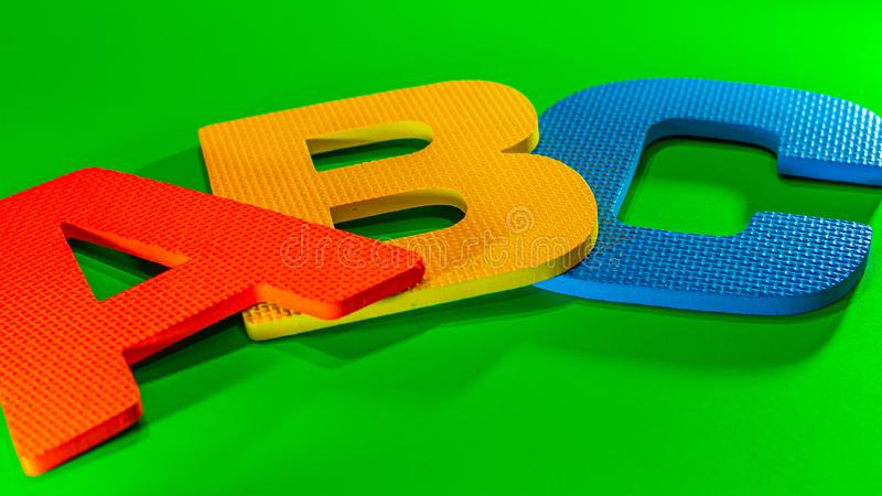 ABC: Alphabet Starts in Primary Colors. The first three letters of the alphabet, A, B and C, are seen as textured foam cut-outs in primary colors stock photo