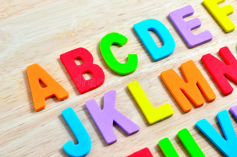ABC alphabets. On wooden background stock photo