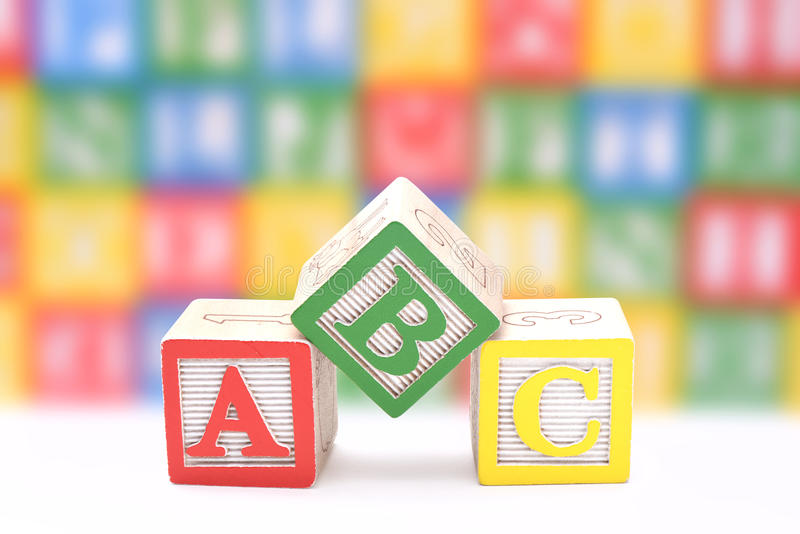 ABC blocks. On a colorful blurred background stock photography