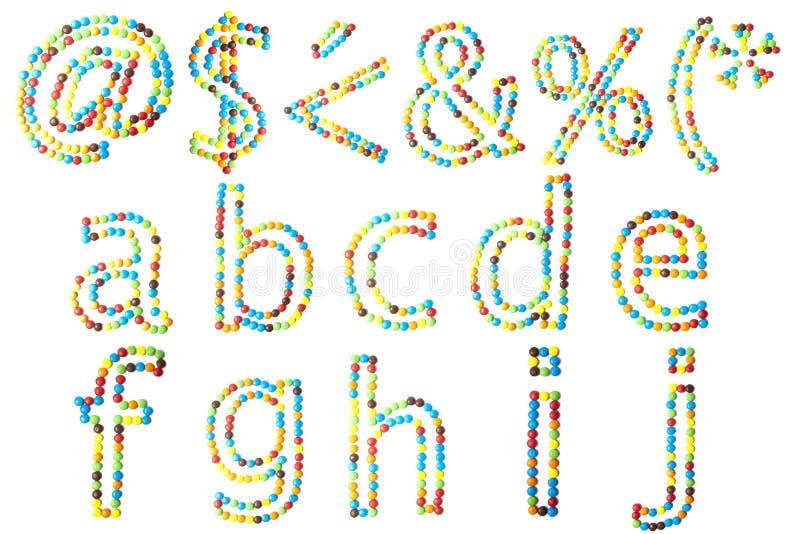 ABC en casquillos más inferiores hechos del caramelo aislado fotos de archivo