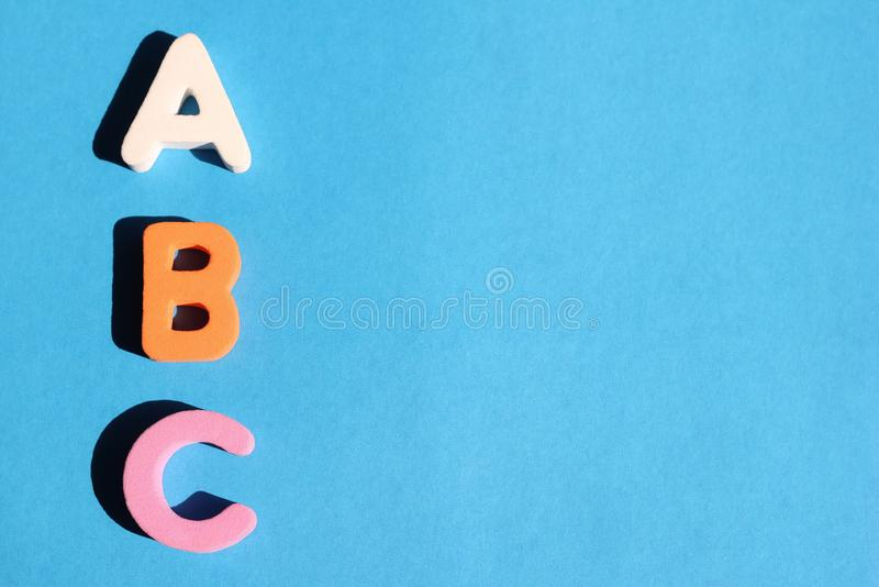 ABC first letter of the English alphabet on a blue background. Empty space for text. Learning foreign language. English for royalty free stock image