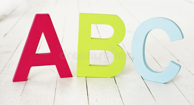 ABC on the floor. Large painted ABC letters on floorboards stock photos