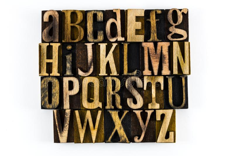 Abc letterpress алфавита изолированный древесиной стоковое изображение rf