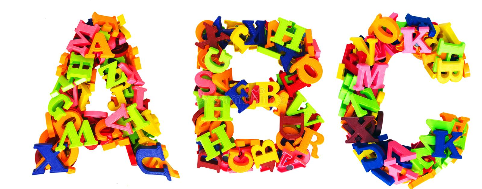 ABC made up of 100s of magnetic letters isolated royalty free stock photo