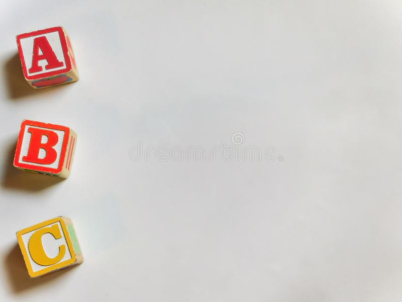 ABC wooden blocks to the left royalty free stock image