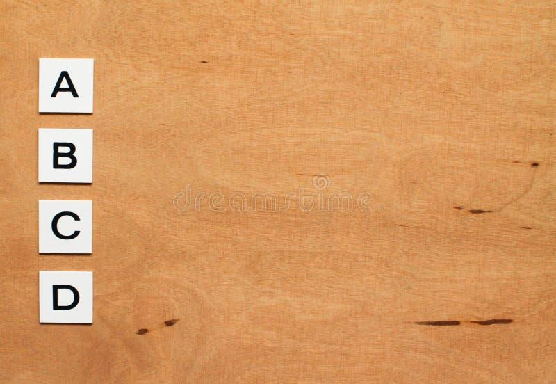 ABCD-Test auf dem hölzernen Hintergrund stockfotos