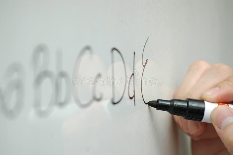 ABCs. Writing ABCs on a whiteboard
