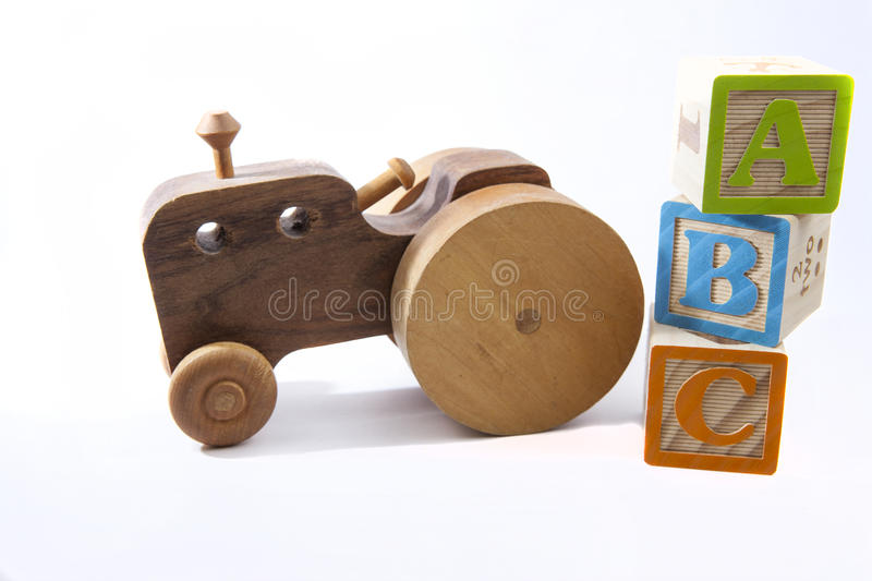 ABCs and old toy car or tractor stock photo