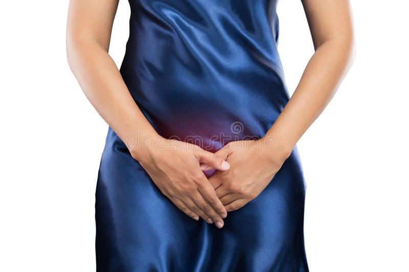 Abdomen. Woman with hands holding pressing her crotch lower abdomen. Medical or gynecological problems, healthcare concept royalty free stock images