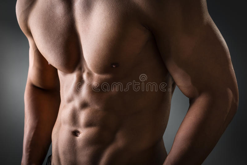 Abdominal and pectoral muscle. Young man with well trained abdominal and pectoral muscle stock photo