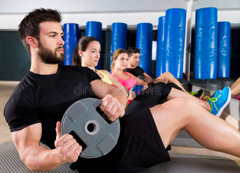 Abdominal plate training core group at gym royalty free stock photography