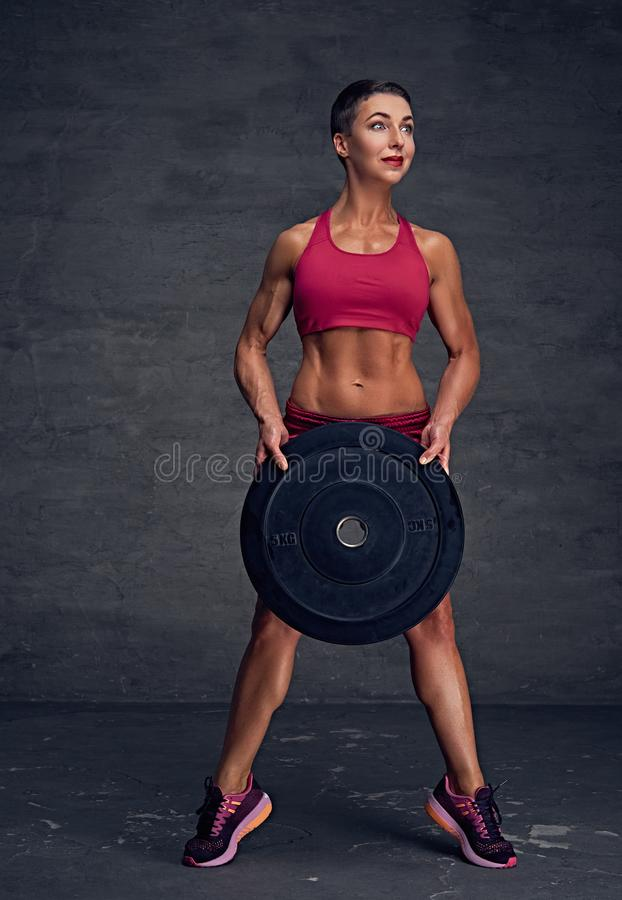 Abdominal r female holds barbell weight. stock photos