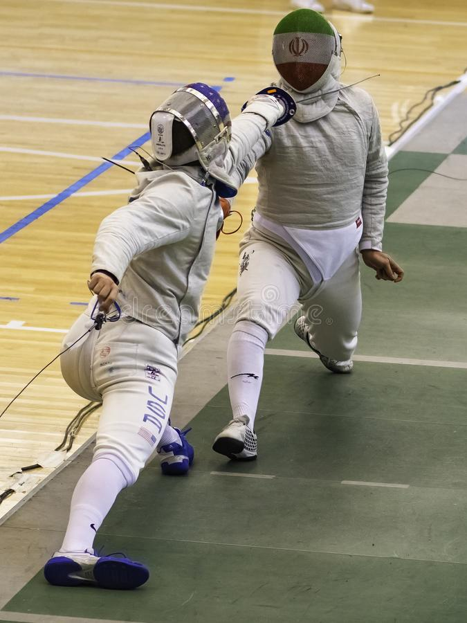 Abedini iran against MACKIEWICZ Andrew usa. Spain May 19 2019 International Federation of Fencing World Championship Villa de Madrid stock image