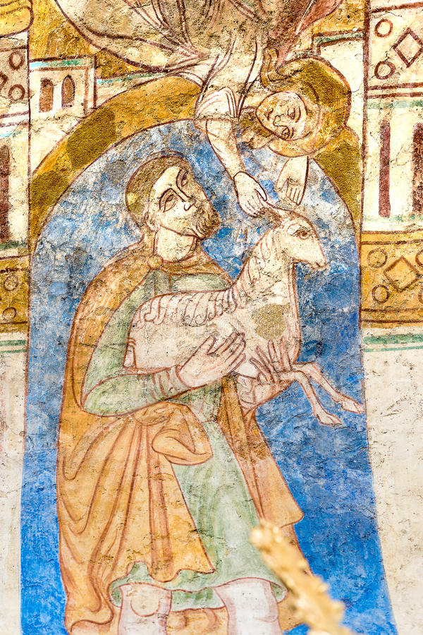 Abel sacrifices a lamb. Withch is received by an angel, fresco in Engum church, Denmark, July 15, 2015 royalty free stock image