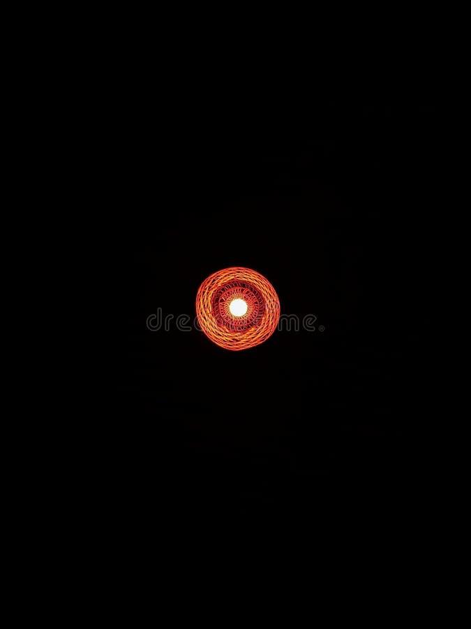 Abendessen unter einem roten Licht stockbilder
