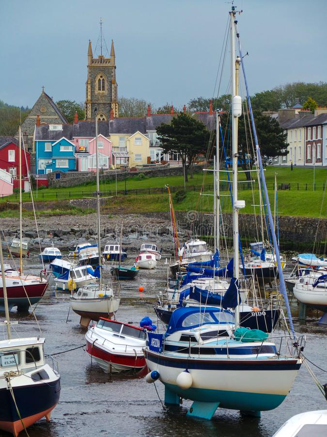 Boats at Low tide. Aberaeron, United Kingdom - May 29 2013:   Boats resting on the beach at low tide stock photos