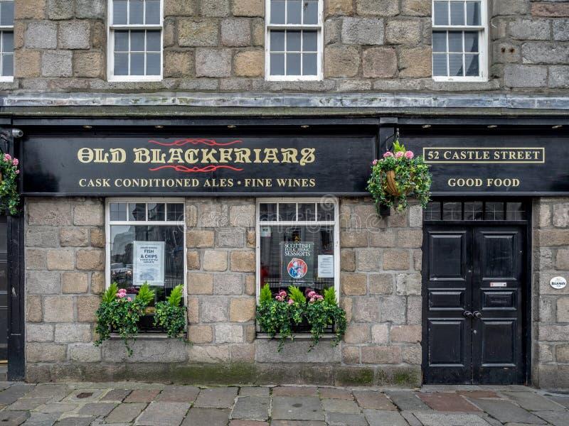 Old Blackfriars pub, Aberdeen. ABERDEEN, SCOTLAND: JULY 23: Exterior facade of the Old Blackfriars pub in the evening on July 23, 2017 in Aberdeen, Scotland. The stock images