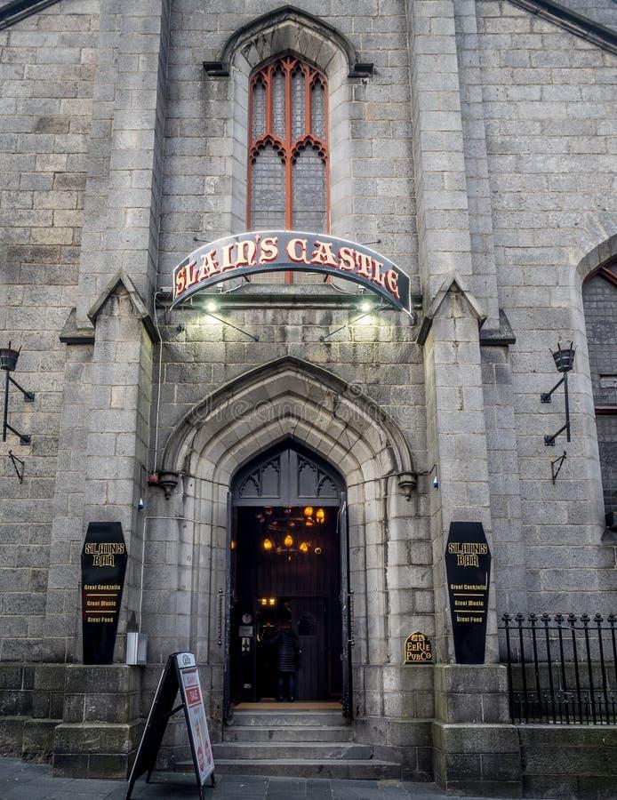 Slains Castle pub, Aberdeen. ABERDEEN, SCOTLAND: JULY 23: Exterior facade of the Slain`s Castle pub in the evening on July 23, 2017 in Aberdeen, Scotland. The stock photos