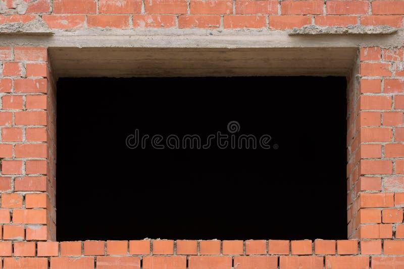 Abertura en una pared de ladrillo fotos de archivo