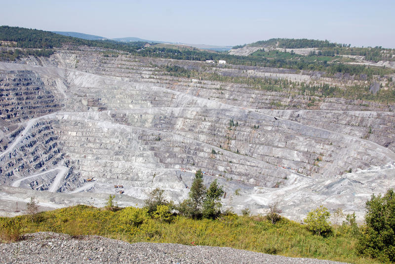 Abestos mine. Asbestos, Quebec, Canada. Asbestos is a set of six naturally occurring silicate minerals used commercially for their desirable physical stock photos