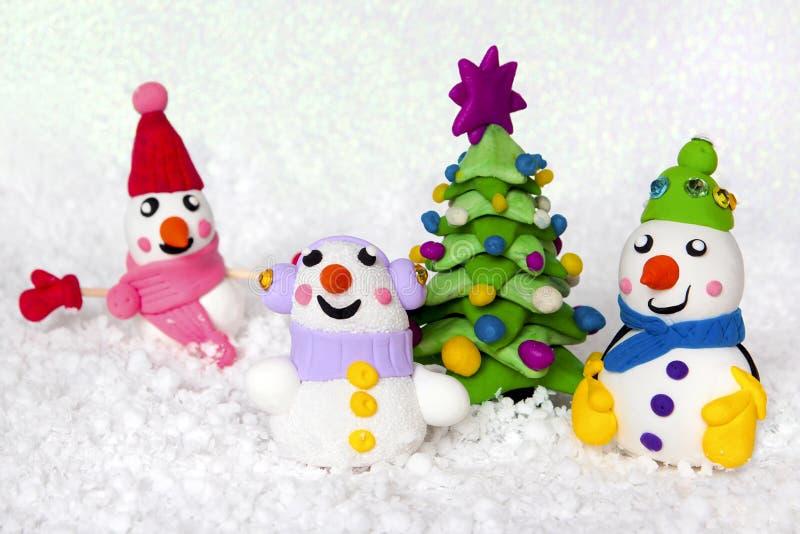 Abeto e bonecos de neve fotografia de stock