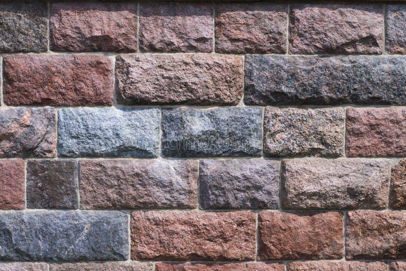 Abgebrochener Steinwandhintergrund stockfotos