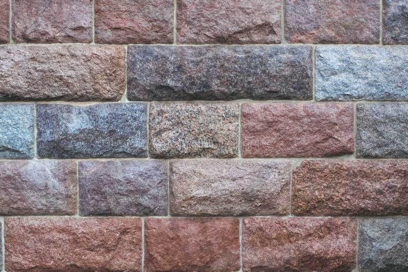 Abgebrochener Steinwandhintergrund stockfoto