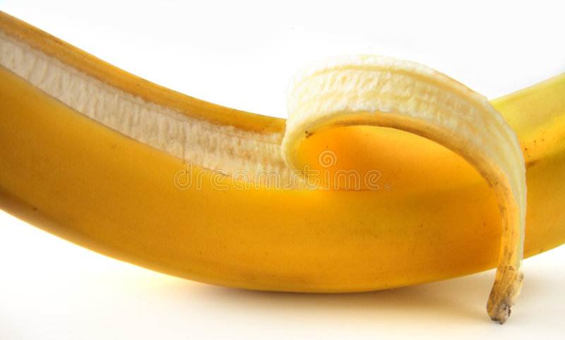 Abgezogene Banane der Nahaufnahme Hälfte lizenzfreies stockfoto
