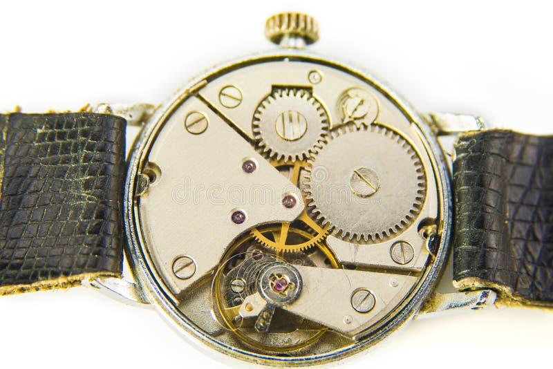 Abierto detrás de la maquinaria del reloj del vintage, detalle macro imágenes de archivo libres de regalías