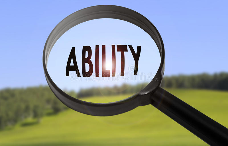 Ability. Magnifying glass with the word ability on blurred nature background. Searching ability concept stock image