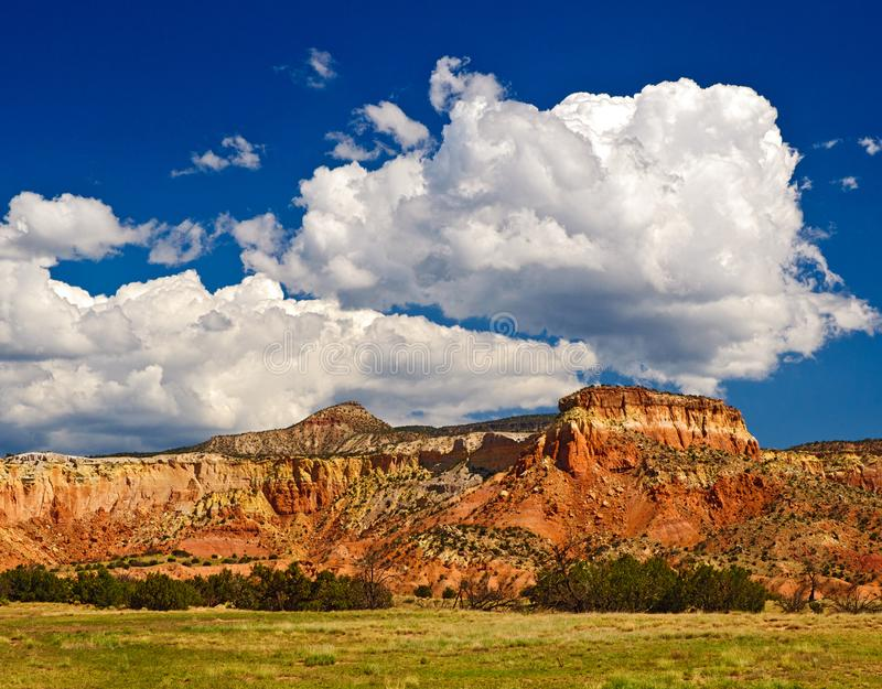 Abiquiu New Mexico landscape and clouds. Abiquiu New Mexico landscape with cliffs and clouds. Near Georgia O`Keefe house and Ghost Ranch royalty free stock photos