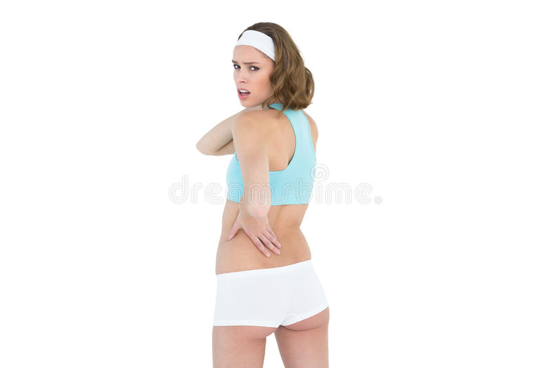 Abiti sportivi d'uso della donna snella attraente che esaminano macchina fotografica fotografia stock