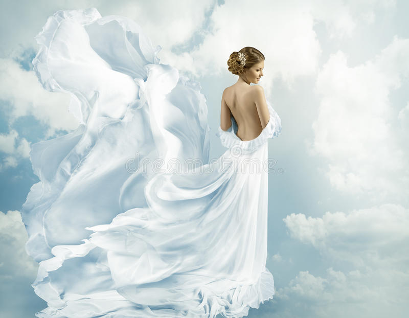 Abito di volo di fantasia delle donne, vestito d'ondeggiamento che soffia sul vento fotografie stock