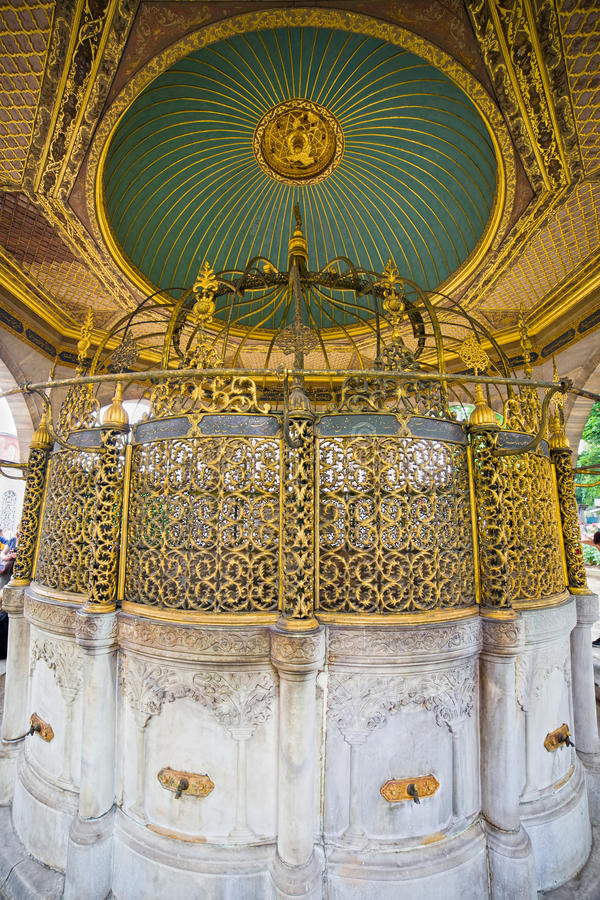 Ablution Fountain. Ornate fountain for ritual ablution before entering the Hagia Sophia in Istanbul, Turkey royalty free stock photography