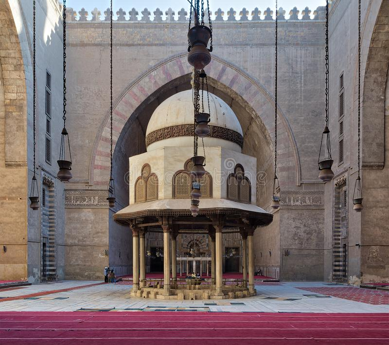 Ablution fountain of the Mosque of Sultan Hasan, Medieval Cairo, Egypt. Cairo, Egypt - December 16, 2017: Courtyard of the Mosque of Sultan Hasan with Ablution royalty free stock image
