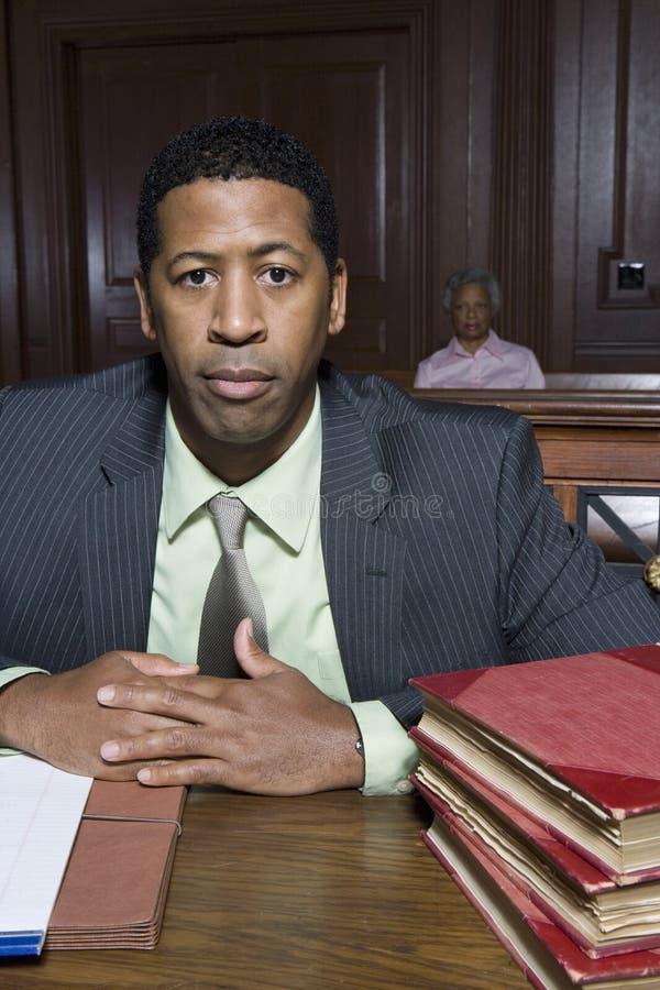 Abogado Sitting In Courtroom foto de archivo