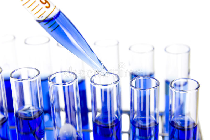 Aboratory glass pipette drop solution in tube. Laboratory glass pipette drop solution in test tube stock image