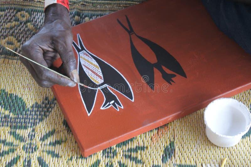 Aboriginal artist creating a dot painting royalty free stock image