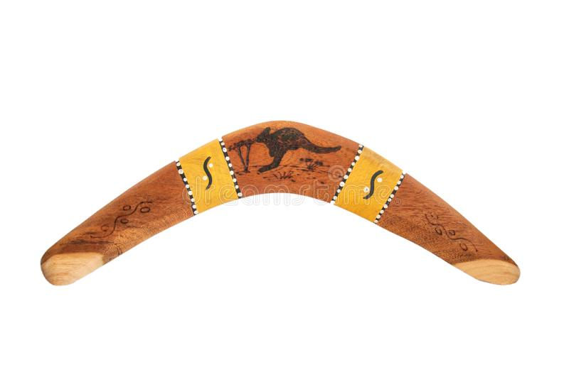 Aboriginal wooden boomerang isolated. Aboriginal brown wooden boomerang with painted kangaroo and tribal pattern, isolated royalty free stock photo