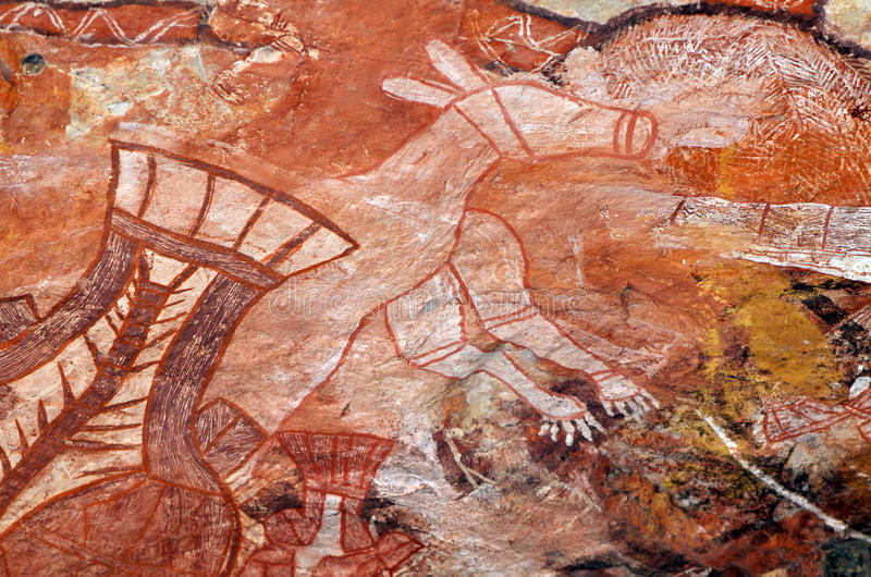 Aboriginal Rock Painting. Aboriginal rock art painting representing a kangaroo; Arnhem Land, Northern Territory, Australia royalty free stock images