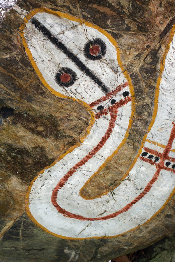 Aboriginal rock painting, rainbow serpent. Aboriginal rock painting representing the rainbow serpent, Mount Coot-Tha, Queensland, Australia stock photo