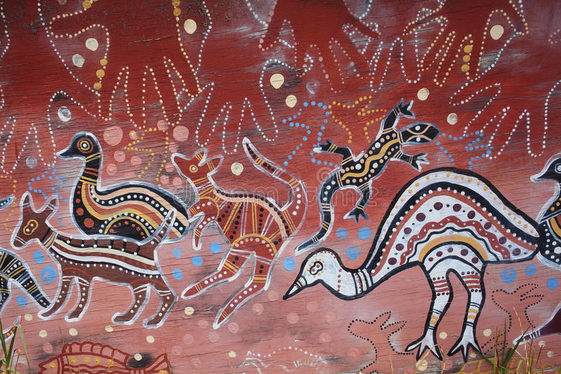 Aborigine art on wood. A traditional Aborigine artwork painted on a peace of old wood