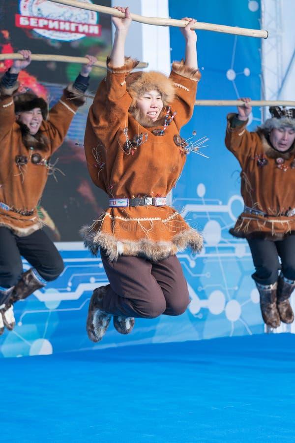 Aborigine female dancer jumping in national clothes of indigenous people Kamchatka Peninsula. Koryak National Dance stock images