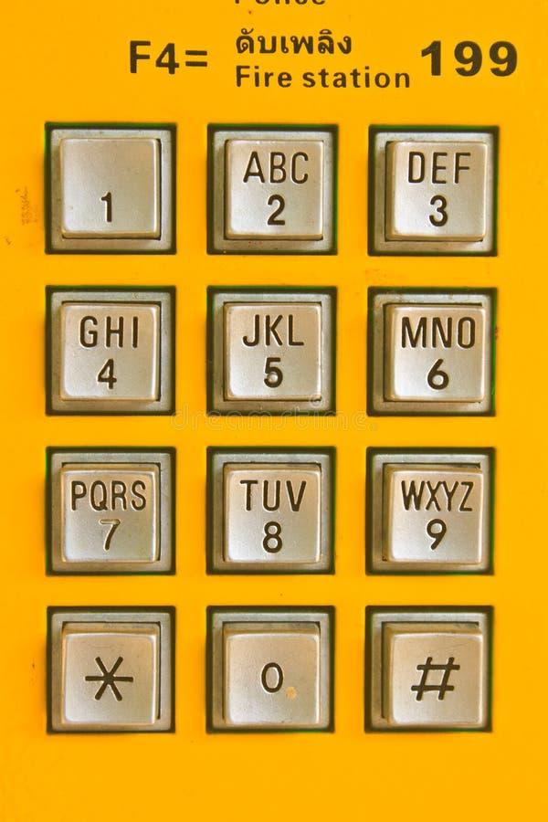 Abotone el teléfono público del número foto de archivo
