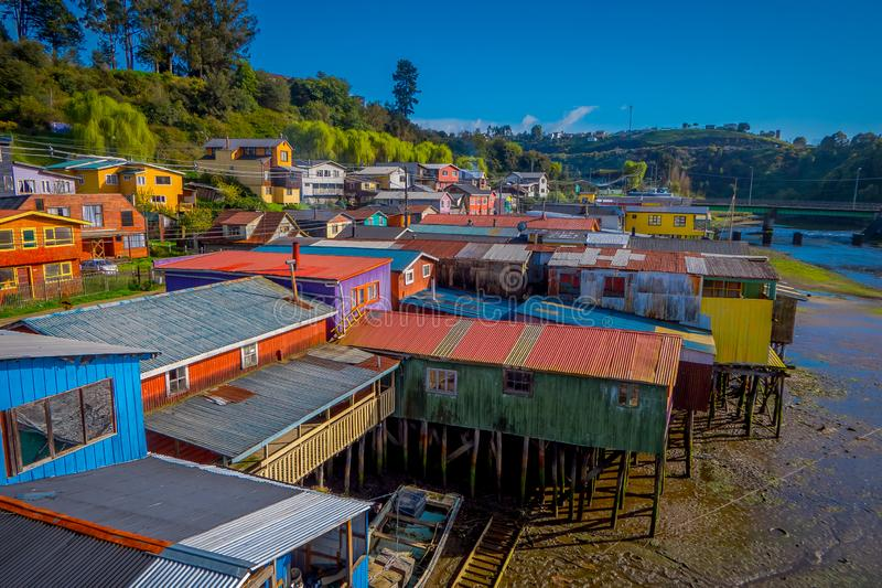 Above beautiful and colorful houses on stilts palafitos in Castro, Chiloe Island. Located in Chile in sunny day royalty free stock images