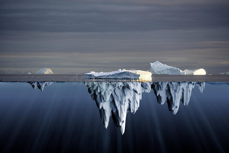 Above and below water view of icebergs royalty free stock images