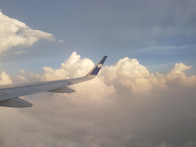 Above the cloud with airplane stock photography