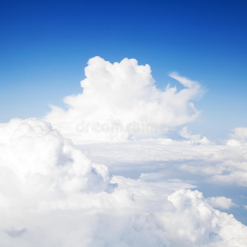 Above the clouds, airplane view stock images