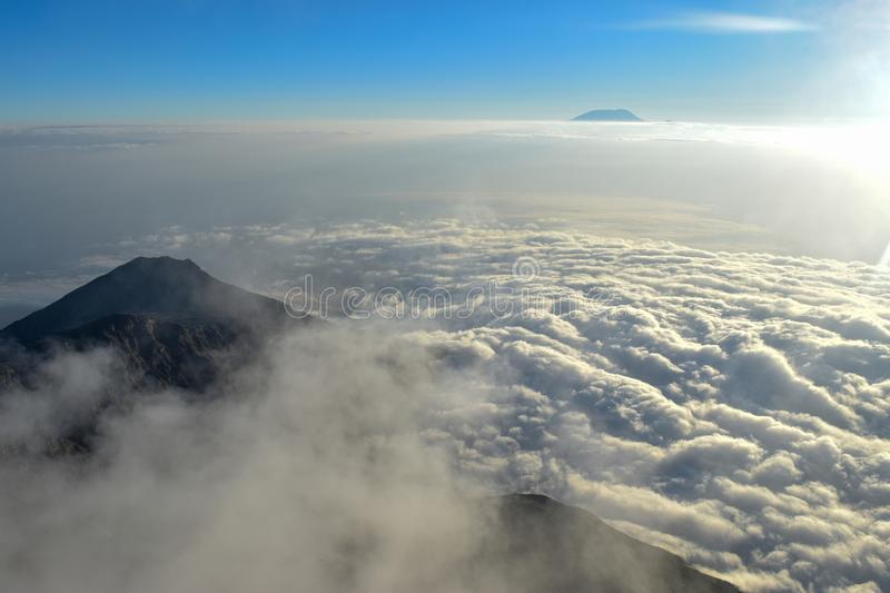 Above the clouds at Mount Meru, Arusha National Park, Tanzania. Mount Meru, Arusha National Park, Tanzania stock image